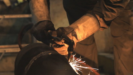 Industrial worker cutting steel by using metal torch.