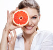 smiling brunette european woman with mottled orange slice
