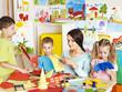 Children with teacher at classroom.