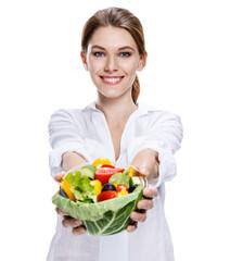 merry european woman & vegetable salad - isolated