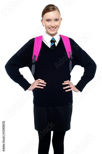 Smiling schoolgirl posing with confidence
