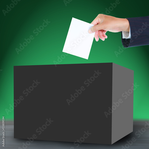 Hand with ballot and box