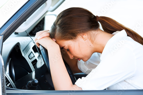 Girl sleeps in a car