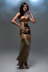 Woman in golden brown evening dress