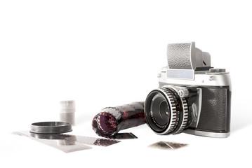 Old photo camera on white background