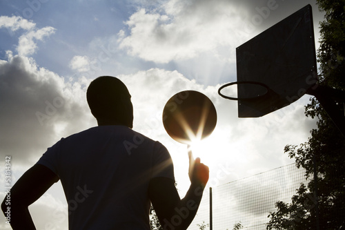 Basketball Player Silhouette Spinning the Ball