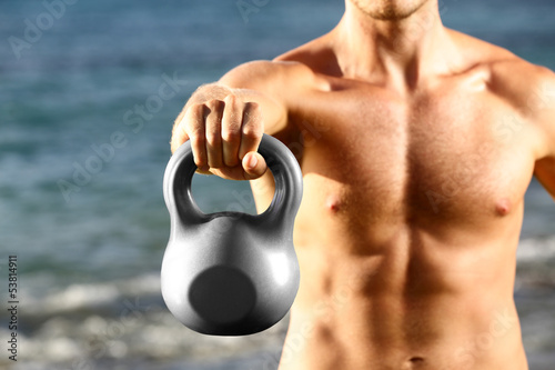 Crossfit fitness man training with kettlebell