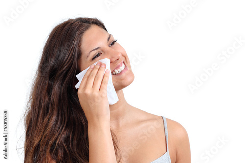Attractive woman cleaning her face with a tissue