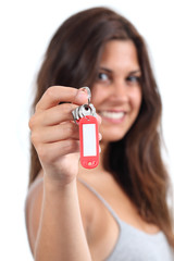 Attractive woman showing a home keys