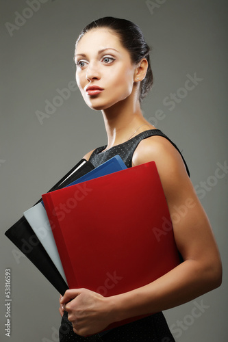 woman with folders over gray background