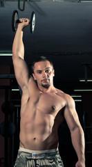 Bodybuilder doing light weight exercise