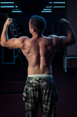 Showing muscles in gym