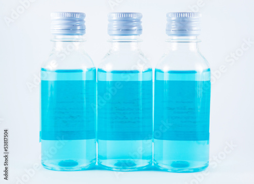 Blue liquid in plastic bottle