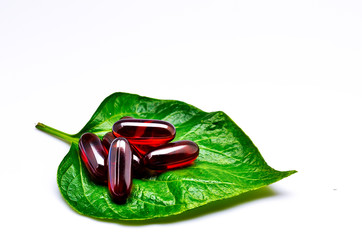 vitamins on green leaf