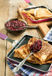 Crepes with black currant jam