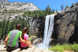 Fototapety Hikers couple resting in Yosemite park - waterfall