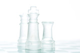 Leadership concept - glass chess on chess board