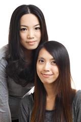 Two asian woman friends