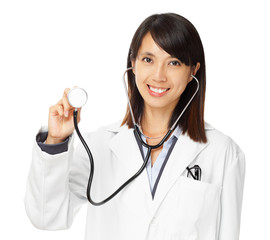Asian female doctor holding stethoscope