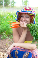 happy woman with bunch of carrots