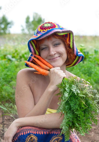 red-haired woman with bunch of carrots