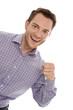 Lachender erfolgreicher junger Mann isoliert