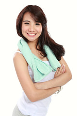 Smiling happy asian woman fitness model with arms crossed