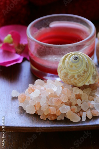 pink salt, candle and towel - spa concept