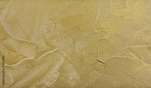 modern stucco wall with gold particles