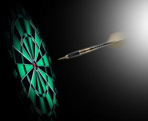 Shot of darts in bullseye on dartboard