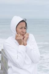Woman white jumper cold season at sea
