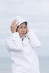 Woman cold autumn season at ocean
