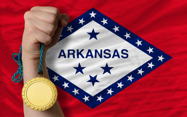 Gold medal for sport and  flag of american state of arkansas