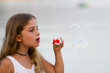 Soap bubbles - lovely girl blowing bubbles