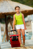Travel, summer - young girl on the road to summer resort