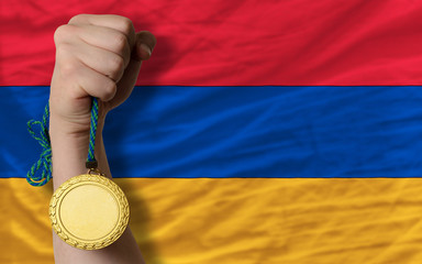 Gold medal for sport and  national flag of armenia