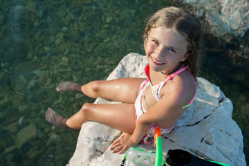 Summer joy, beach - young girl playing in the sea