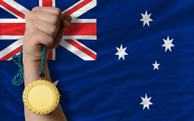 Gold medal for sport and  national flag of australia