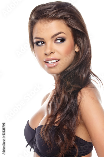 Portrait of the woman with beauty long brown hair - posing at st