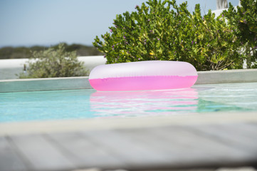 Inflatable ring floating on water in a swimming pool