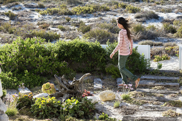 Woman walking in vegetation