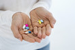 Close-up of a woman's hand holding medicines