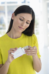 Woman holding a blister pack of medicine