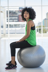Portrait of a woman sitting on a fitness ball
