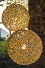 Close-up of nest shaped lamps hanging from ceiling