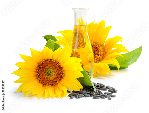 Sunflower oil with flower and by seed on white background