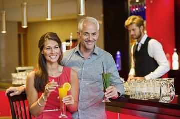 Couple enjoying drinks at the bar counter