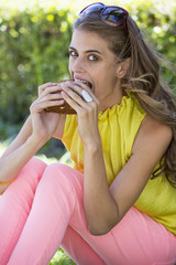 Portrait of a woman eating sandwich