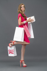 Portrait of a woman posing with shopping bags