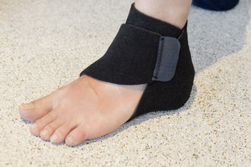 Close-up of heel wrap around the ankle of a person